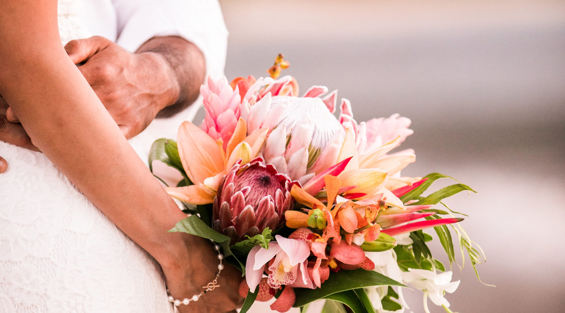 Elopement wedding bouquet on the beach in Hawaii.