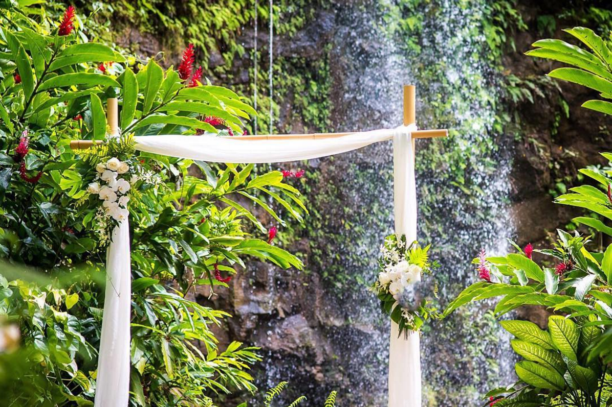 Bamboo arch at for waterfall wedding ceremony