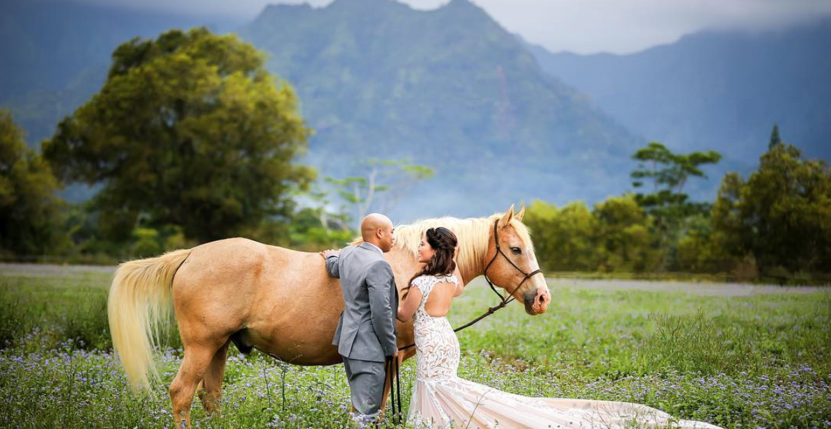 Bride and Groom with beautiful horse for a first look before their intimate Kauai wedding ceremony