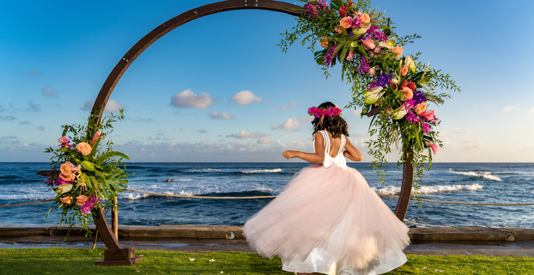Kauai Flower girl and circle arch at an oceanfront private venue