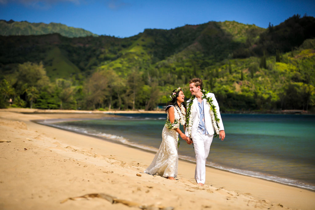 Bride and Groom just married at Hanalei Bay Kauai in the morning