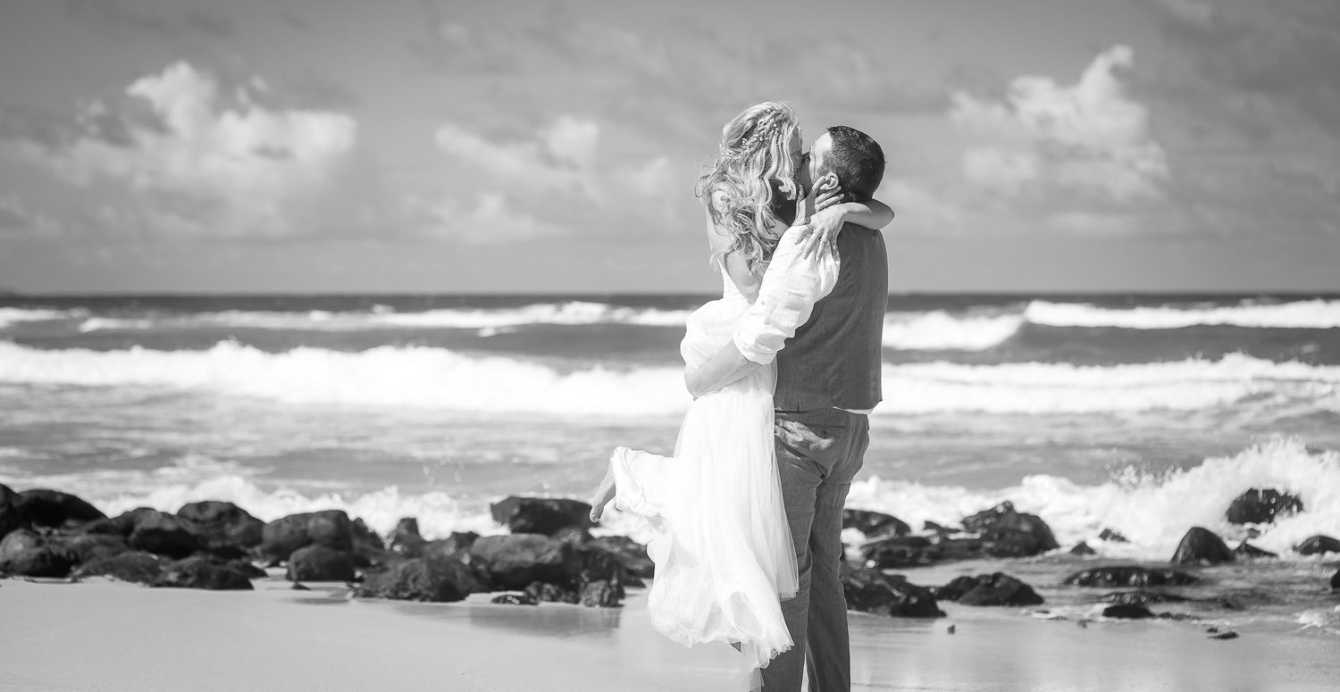 Bride and Groom sharing an intimate moment after their beautiful  beach elopement