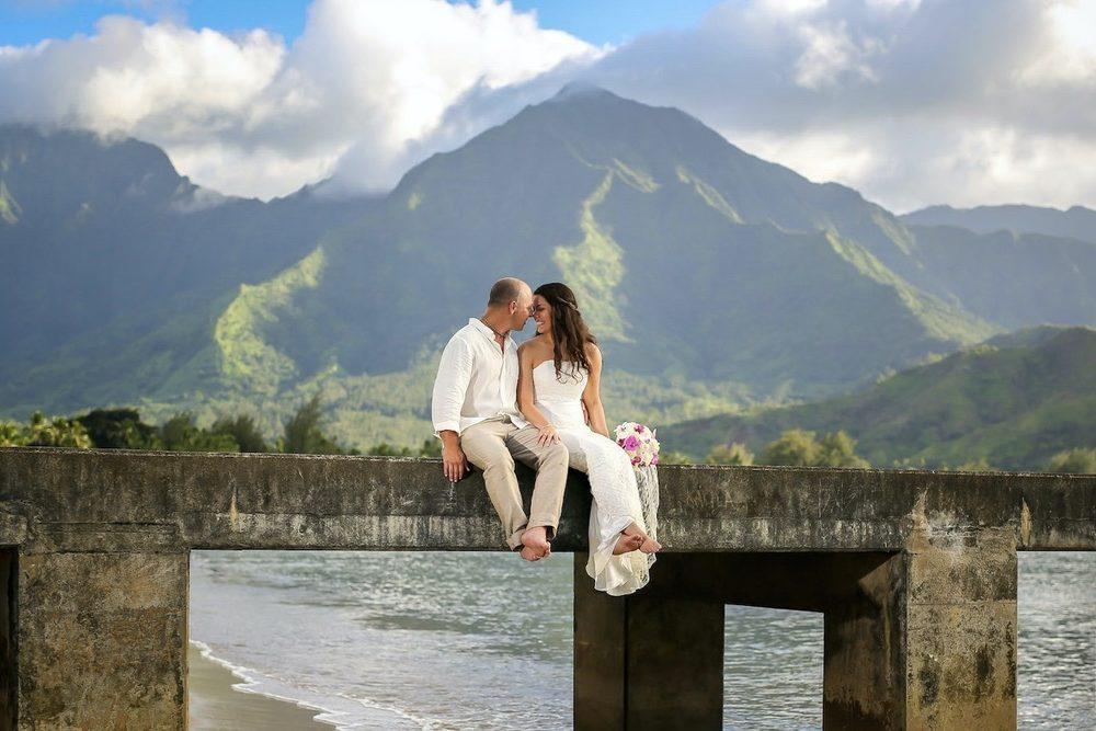 Romantic moment at Hanalei Pier for just married couple