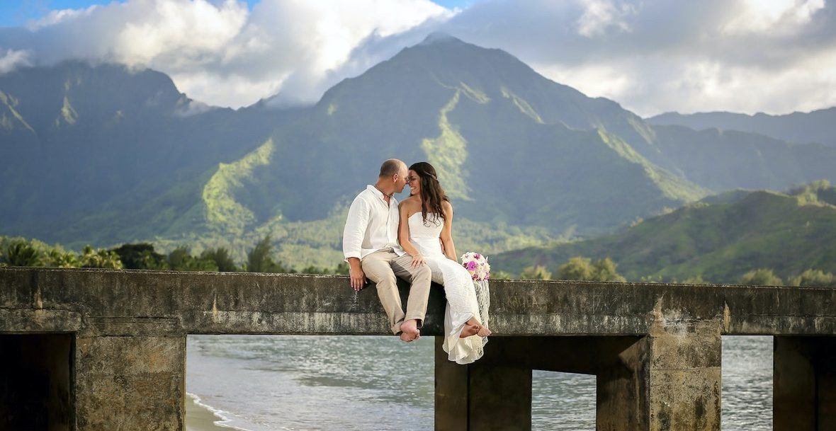 Romantic moment between the bride and groom after their elopement at Hanalei Bay