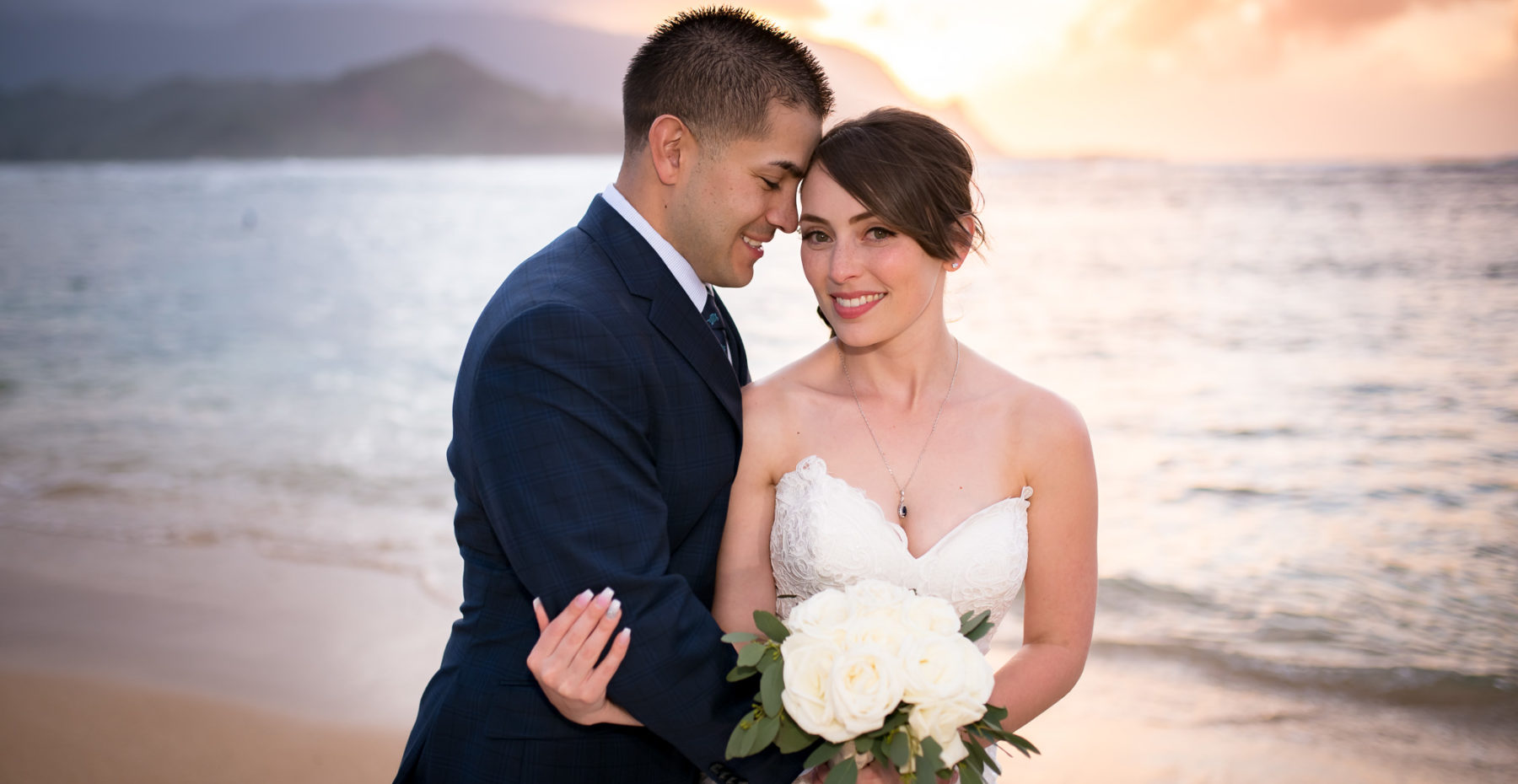 Just married couple at sunset in Princeville after elopement on Kauai