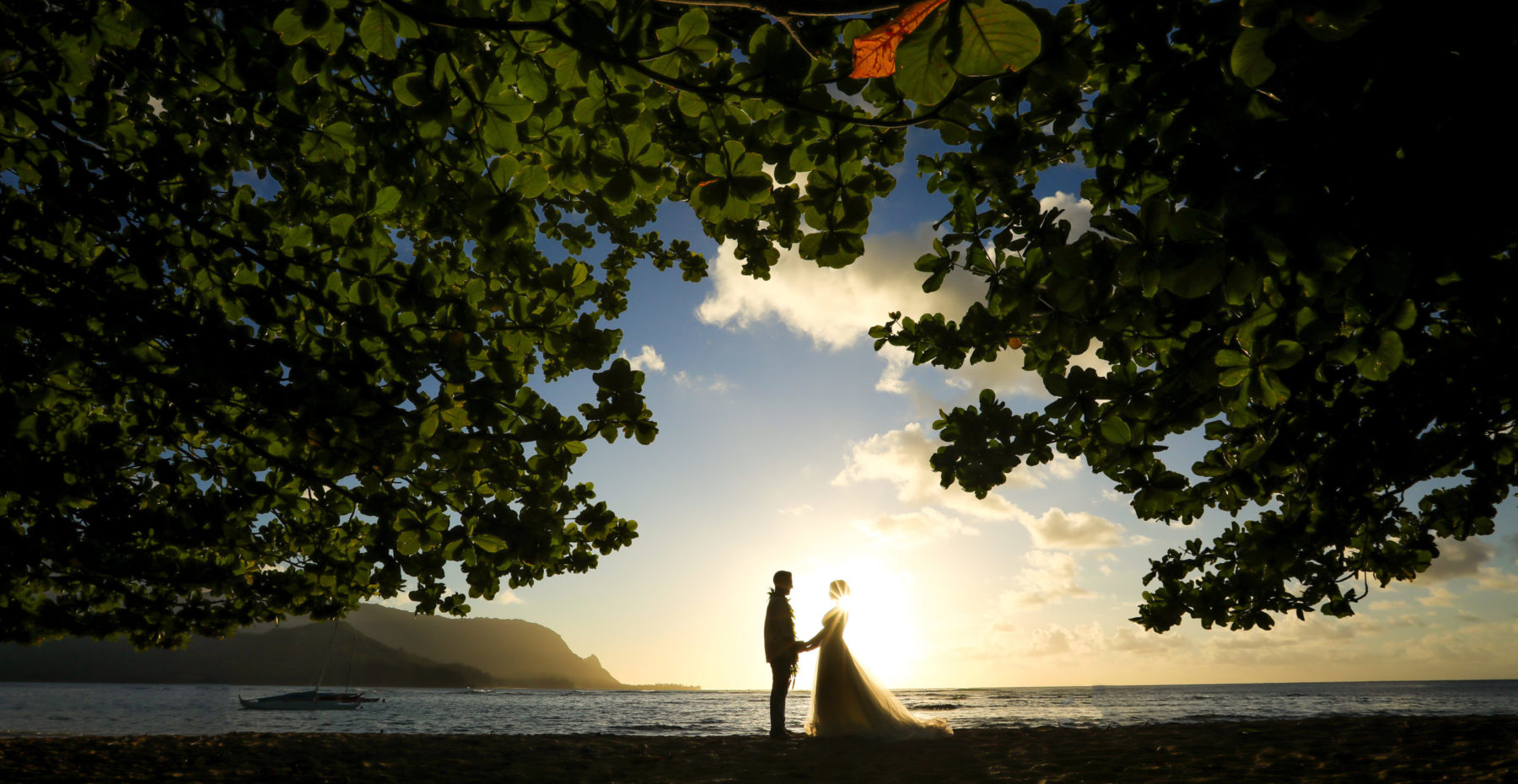 Romantic wedding couple just married on Kauai at Hanalei bay